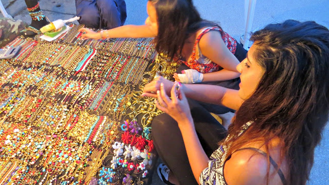 Lifestyle Enthusiast - Choosing out handmade bracelets in Thailand