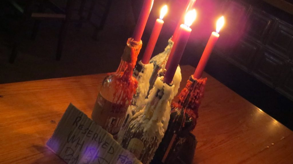 Lifestyle Enthusiast - Streat Feast - Melting wax on bottles as candleholders