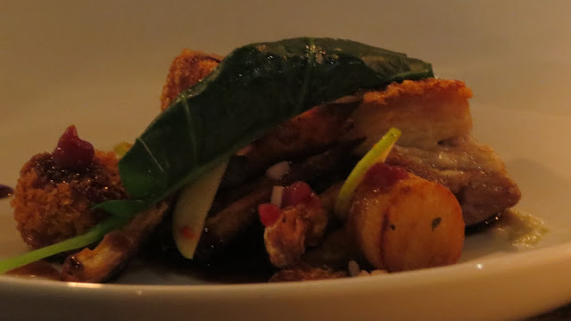 Lifestyle Enthusiast - Main of Confit Pork Belly with roasted sweet potatoes, chorizo crumble and pickled shallots