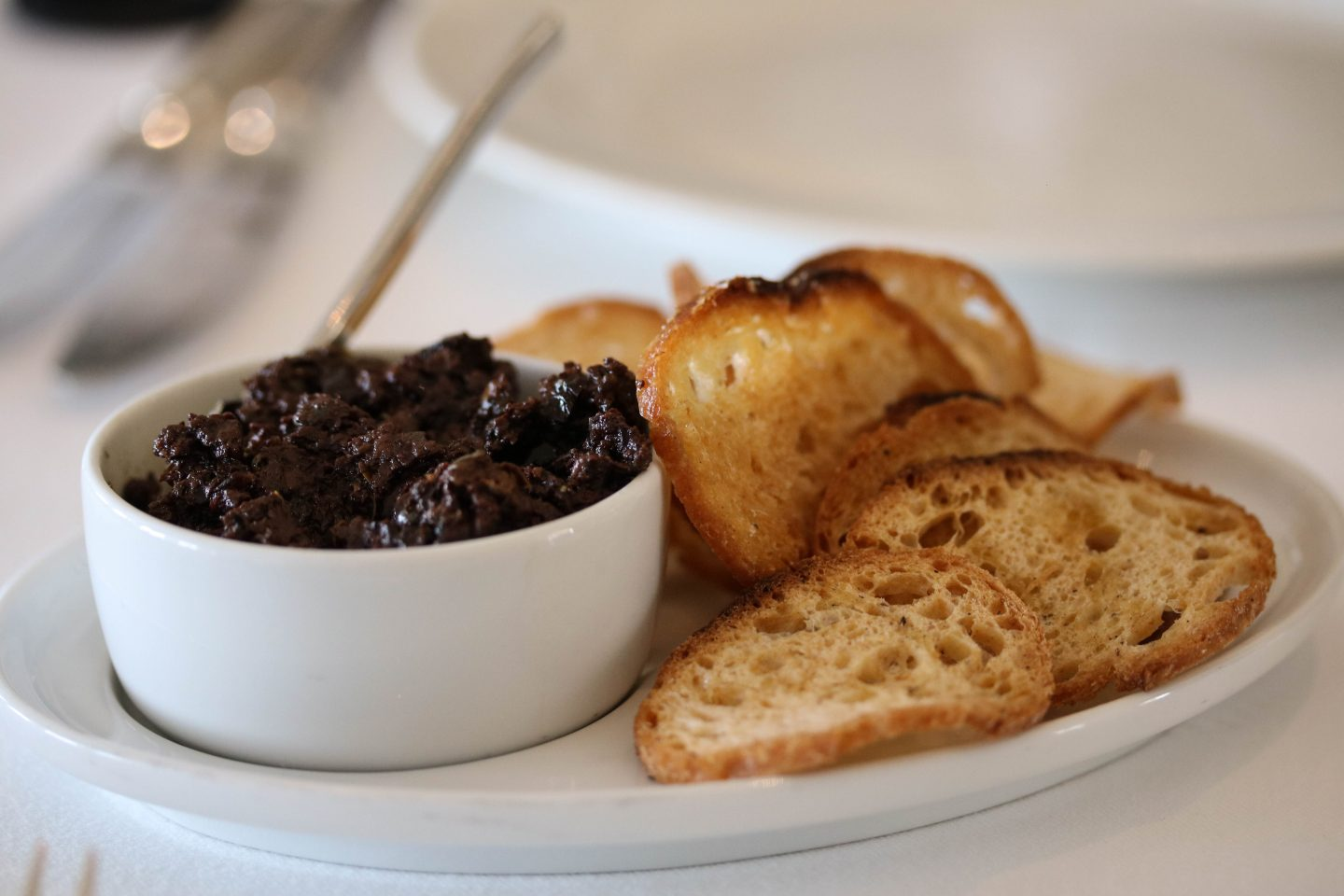 Olive tapenade with crisp bread at La Petite Maison, the best restaurant for lunch in Dubai on the Lifestyle Enthusiast blog