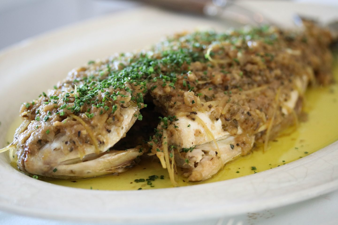 Fish, herbs and olive oil in papillotte at La Petite Maison, the best restaurant for lunch in Dubai on the Lifestyle Enthusiast blog