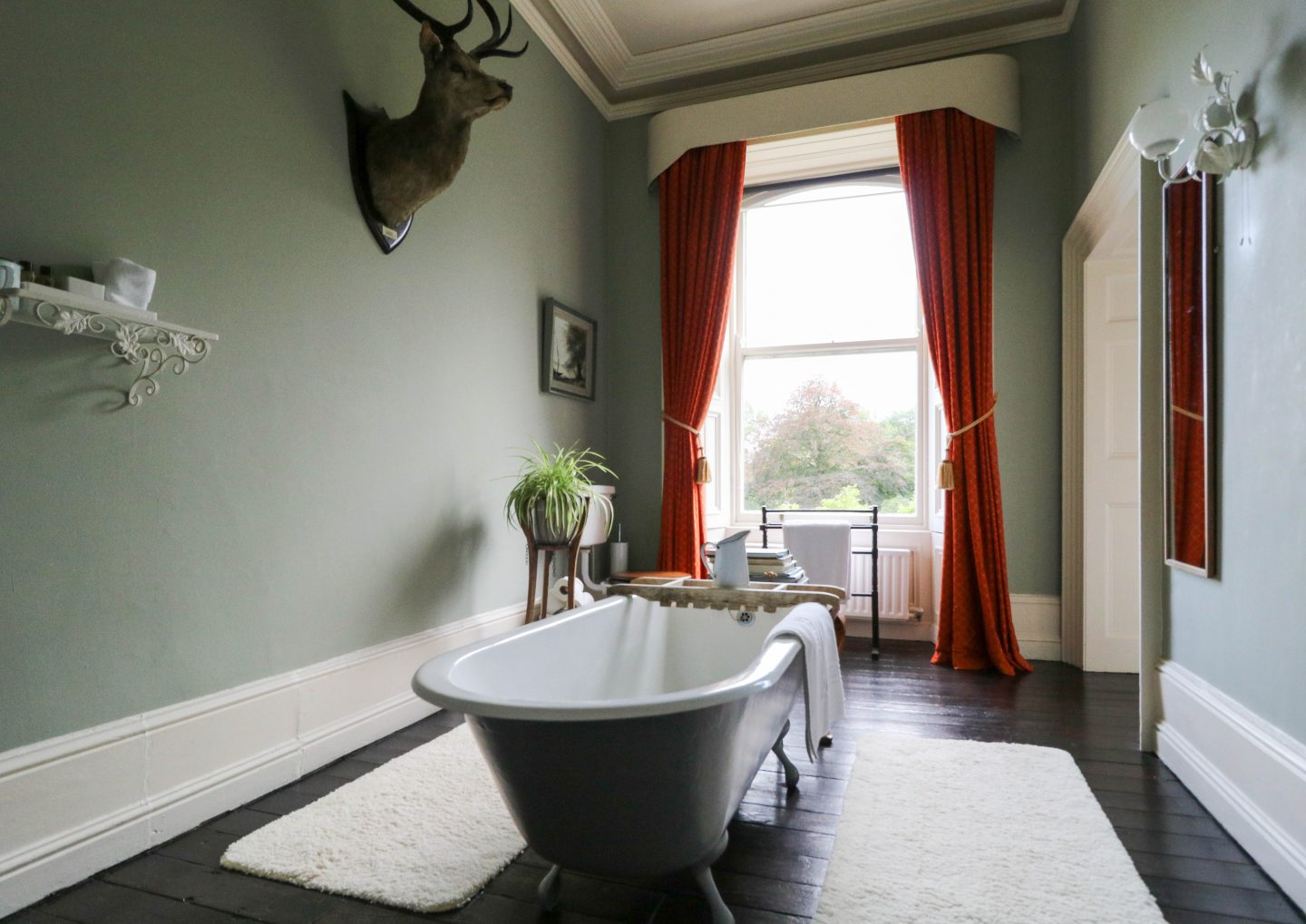 Ballyvolane House_Country Retreat in County Cork Ireland_ Bathroom with vintage tub and views